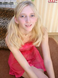 Beautiful teen with innocent face and pretty shaved pussy posing in sexy pink peignoir.